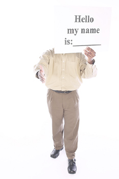 """3 Ways to Overcome Face to Face Networking Awkwardness represented by a person holding a sign that says """"hello, my name is"""""""