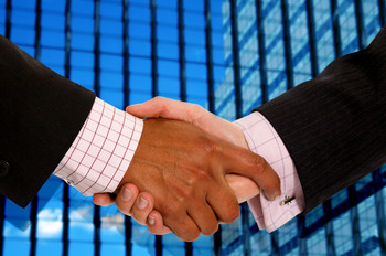 shaking hands after hiring a new employee