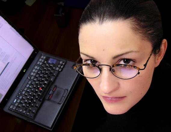 a Hispanic job seeker next to her computer