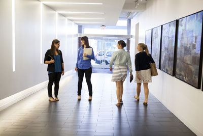 Employees walking together in a hallway