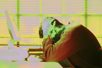4 ways to Avoid Becoming a Workaholic represented by a frustrated employee