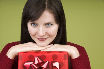 A lady smiling with a gift