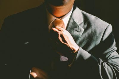 A man adjusting his tie