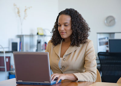 A woman working on a laptop