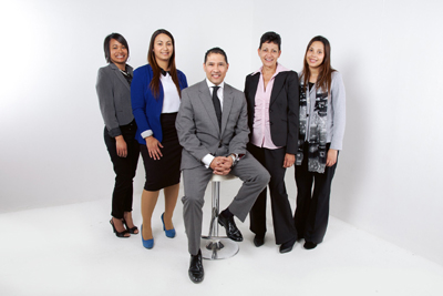 People posing for picture in business clothes