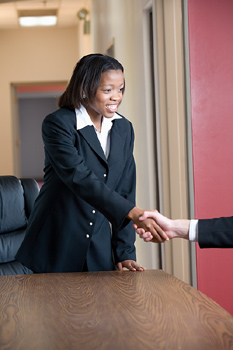 soft skills being demonstrated by good communication and hand shaking