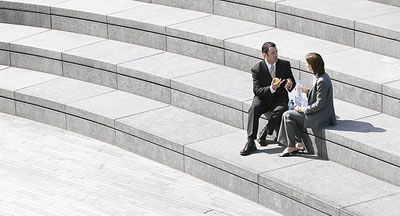 Person in business clothes sitting on steps