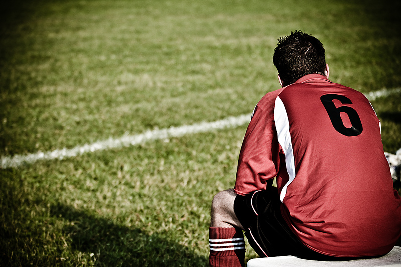 Be Accountable for Great Career Mentoring represented by a soccer player sitting on the bench