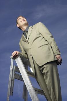 a job seeker climbing a career ladder