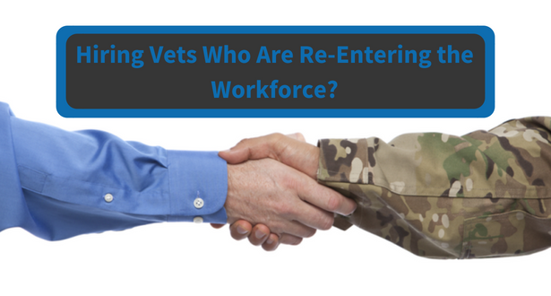 A hand of a civilian hiring manager shaking the hand of a veteran