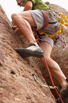 person climbing and pushing their career ahead