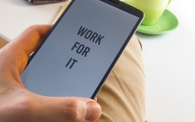 """a smartphone that says """"work for it"""""""
