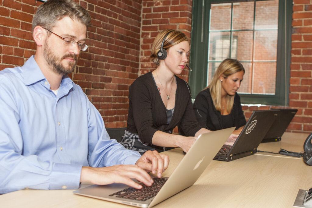 A millennial in an office meeting