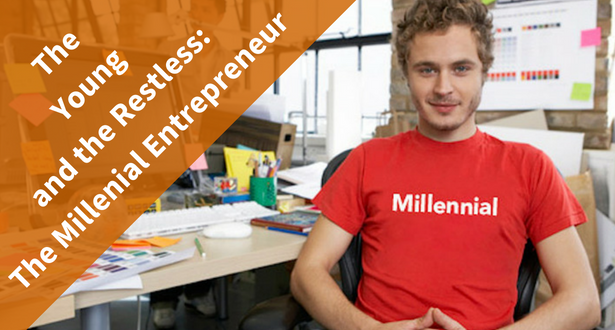 Man with millennial t shirt smiling at a desk