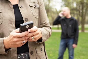 Mobile Recruiting: A New Frontier in Talent Acquisition represented by a job seeker on their phone