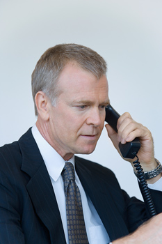 Phone Interview Secrets to Success with picture of job seeker on phone interview