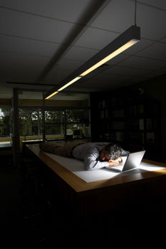 employee working late considering getting a new job
