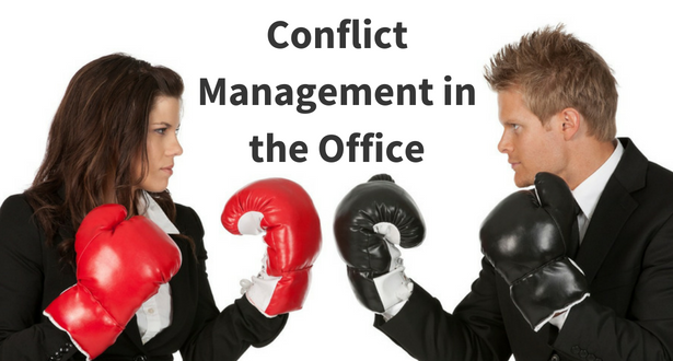 Two office workers with boxing gloves on