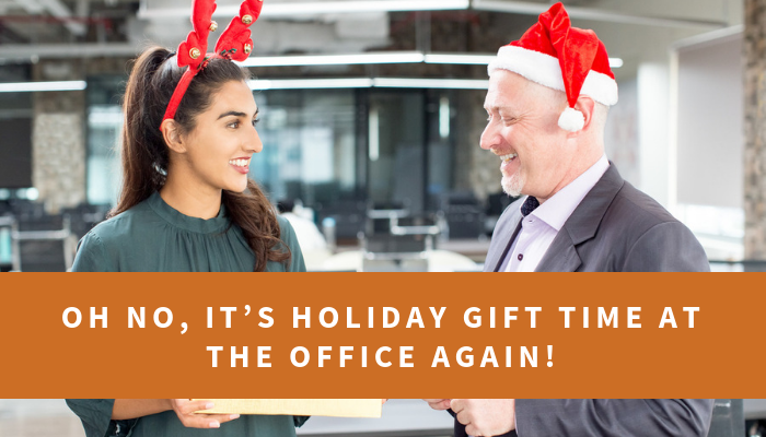 Two office workers smiling with Santa hats on