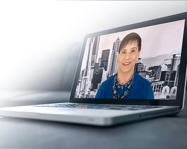 Picture of Dana Manciagli on a laptop screen