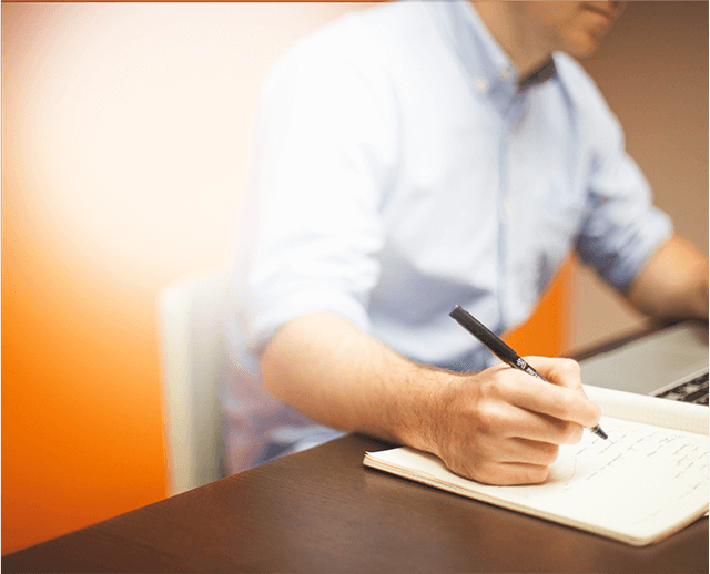 Picture of a person taking notes